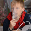 Cute boy makes inhalation — Stock Photo #29825837