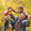 Elderly couple and grandchildren rest fall — Stock Photo