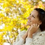 Nice young woman autumn park — Stock Photo #29826015