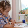 Baby draws paints at the table — Stock Photo
