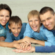 Happy family in blue  — Stock Photo