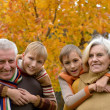 Elderly couple and grandchildren — Stock Photo