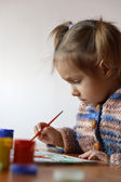 Portrait of a cute baby draws — Stock Photo