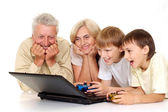 Grandchildren with their glad granddad and granny — Stock Photo