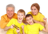 Beautiful family in yellow t-shirts — Stock Photo