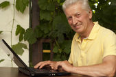 Adorable older man sitting on the veranda — Stock Photo