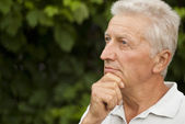 Beautiful elderly man in the park — Stock Photo