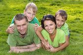 Happy parents and children — Stock Photo