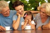Cute family sitting on the veranda — Stock Photo
