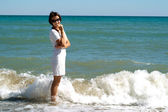 Smiling female enjoying the sea breeze — Stock Photo