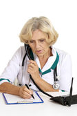 Old nurse with telephone — Stock Photo