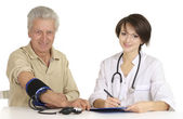 Man came to the reception to the doctor — Stock Photo