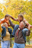 Elderly couple and children rest fall — Stock Photo