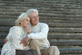 Elderly couple sitting in park — Stock Photo
