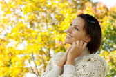 Nice young woman autumn park — Stock Photo