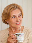 Superb old lady is resting at home — Stock Photo