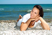 Thoughtful female enjoying the sea breeze — Stock Photo