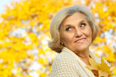 Nice woman standing on a yellow — Stock Photo