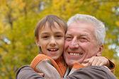 Nice old man with kid — Stock Photo