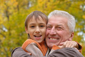 Nice old man with kid — Stock Photo