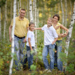 Happy family in a birch forest — Stock Photo #30069513