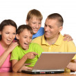Family at the computer — Stock Photo #30069591