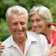 Loving aged couple outdoors — Stock Photo