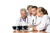 Old lady and doctors — Stock Photo