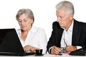 Mature couple in the workplace — Stok fotoğraf