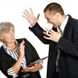 Stock Photo: Businessmshouting at elderly woman