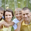 Happy family outdoors — Stock Photo #30070307
