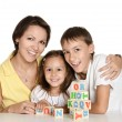 Mother and her kids Playing with cubes — Stock Photo