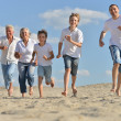 Portrait of a happy family a running barefoot — Stock Photo #30070543