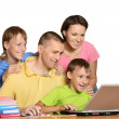 Happy family on the computer. — Stock Photo #30070579