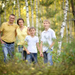 Happy family in the birch forest — Stock Photo