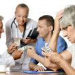 Doctors and patients — Stock Photo