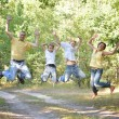 Family jumping in a park — Stock Photo