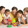 Family playing indoors — Stock Photo