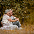 Stock Photo: Old couple in woods.