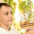Young boy with a model of ship — Stock Photo