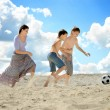 Mother playing football with sons — Stock fotografie