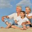 Big happy family relaxing on the sand together — Stock Photo