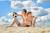 Happy boys sitting outdoors — Stock Photo