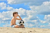 Thinking boy with ball — Stock Photo