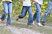 Legs of running people — Stock Photo