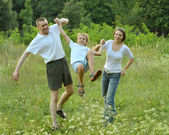 Family having fun in park — Stock Photo