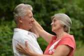 Aged couple dancing outdoors — Stock Photo