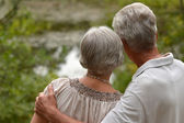 Old couple on fresh air — Stock Photo