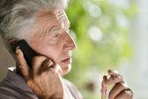 Elderly man fell ill cold — Stock Photo