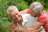 Loving aged couple on nature — Stock Photo